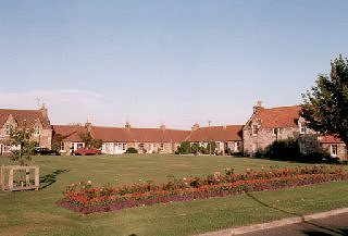 Cottages around village green, New Winton